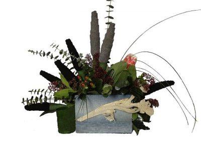 Букет из носков и экзотических живых цветов